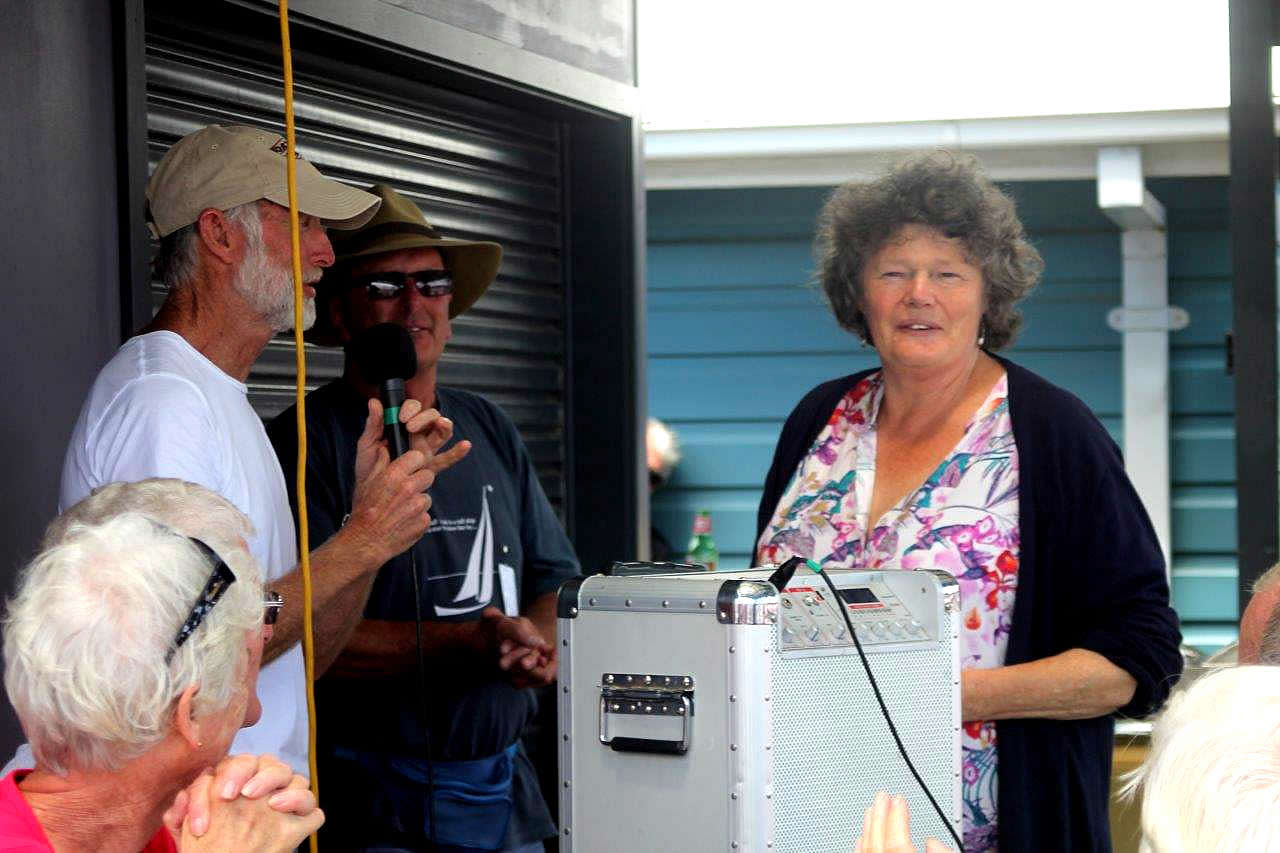Art in the Boat Sheds winner 2015 Dorothy Noble receives her prize from Smile Magill